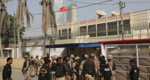 Pakistani security personnel move in the compound of Chinese Consulate in Karachi, Pakistan, Friday. Photograph: AP Photo/Shakil Adil