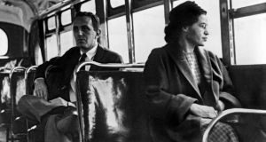 Rosa Parks seated toward the front of the bus, Montgomery, Alabama, 1956. Photograph: Underwood Archives/Getty Images.