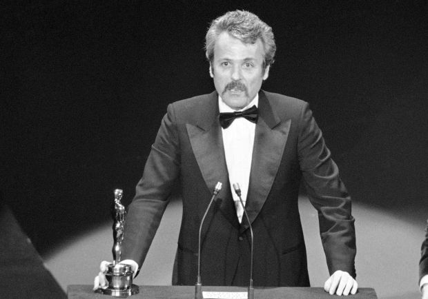 William Goldman accepts his best adapted screenplay Oscar for 'All the President's Men' at the Academy Awards in March 1977. File photograph: AP