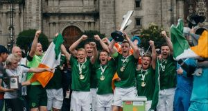 The Irish team lifting the Tier 3 trophy at the Homeless World Cup in Mexico City