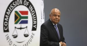 Public enterprises minister Pravin Gordhan  testifies at the state capture inquiry in Johannesburg, which is investigating public sector corruption in South Africa. Photograph: EPA