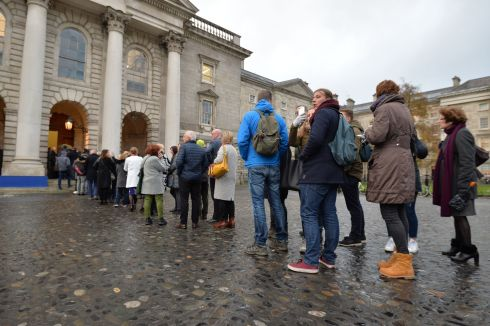 IN MEMORY: People queue to enter a memorial service and celebration of the life of charity worker John Curran, killed in Capetown on November 6th, taking place in in Trinity College, Dublin. Photograph: Alan Betson/The Irish Times