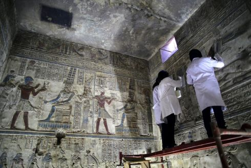 RESTORATION: Egyptians archaeologists work inside the Ipet temple during an event to showcase the restoration work at the Karnak Temple complex, one of Egypt's main tourists attractions in Luxor, 700km south of Cairo, Egypt. The Ipet temple is located on the southern axis of the Amun Re temple in Karnak Temples. The restoration work included the conservation and archaeological cleaning of the temple's walls and the consolidation of the colours of its scenes.  Photograph: Khaled Elfiqi/EPA