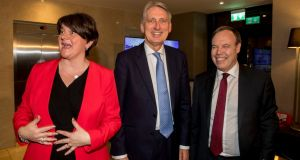 DUP leader Arlene Foster,  UK chancellor of the exchequer Philip Hammond and DUP leader at Westminster Nigel Dodds  at Crown Plaza Hotel in Belfast . Photograph: Liam McBurney/PA