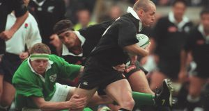 Ireland's Malcolm O'Kelly and New Zealand's Christian Cullen in November 1997. Photograph: Lorraine O'Sullivan/Inpho