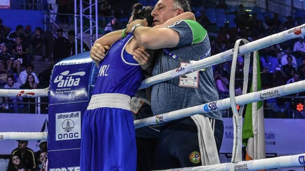 Kellie Harrington celebrates with coaches Zaur Antia and Dmitry Dimitru. Photograph: AIBA
