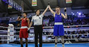 Ireland's Kellie Harrington has her hand raised after getting a split decision to win gold at the  World Women's Elite Championships in New Delhi, India. Photograph: AIBA