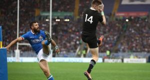New Zealand winger Jordie Barrett collects the high ball ahead of Jayden Hayward of Italy to score a try during the autumn international at the Stadio Olimpico in Rome. Photograph: Phil Walter/Getty Images