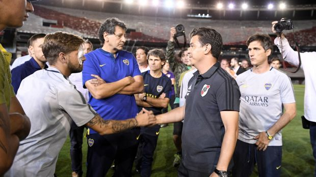 River Plate manager Marcelo Gallardo (right) shakes hands with Boca Juniors' Gonzalo Lamardo after the suspension of the Copa Libertadores final second leg. Lamardo suffered an eye injury after the Boca bus was attacked. Photograph: Matias Napoli/EPA