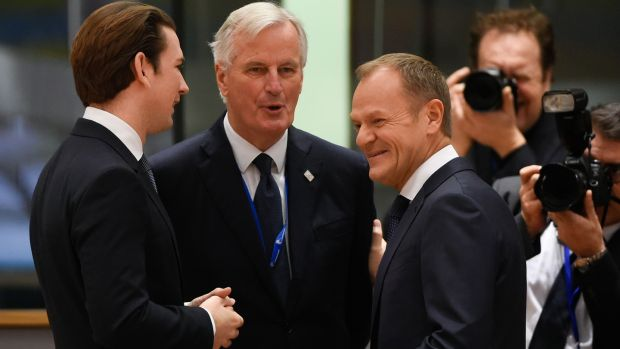 EU chief Brexit negotiator Michel Barnier (centre) chats to Austria's chancellor Sebastian Kurtz (left) and European Council president Donald Tusk before this morning's summit. Photograph: John Thys/AFP/Getty Images