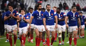 France players leave the pitch after their defeat to Fiji at the Stade de France. Photo: Anne-Christine Poujoulat/Getty Images