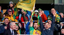 Corofin's Micheal Lundy and Ciaran McGrath lift the trophy. Photograph: Tommy Dickson/Inpho