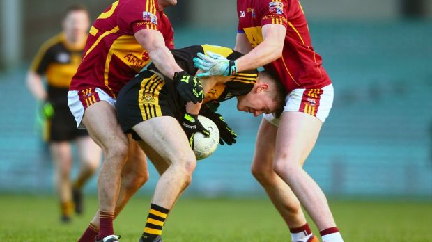 Dr Crokes' Daithí Casey is tackled by Miltown-Malbay's Graham Kelly and Darragh McDonagh. Photograph: Ken Sutton/Inpho