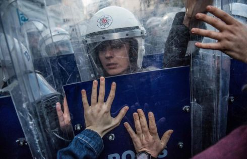 CLASH: A Turkish female riot police officer reacts during clashes with women's rights activists as they try to march to Taksim Square to protest against gender violence in Istanbul, on November 25th, 2018, on the International Day for the Elimination of Violence against Women. Photograph: Bulent Kilic/AFP/Getty