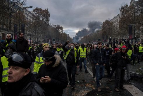 THE YELLOW VESTS: Protesters wearing yellow vests, as a symbol of French driver's and citizen's protest against higher fuel prices, during clashes with police on the Champs Elysee as part of a nationwide protest in Paris on November 24th. The so-called 'gilets jaunes' (yellow vests) protest movement, which has reportedly no political affiliation, is protesting over fuel prices. Photograph: Julien de Rosa/EPA