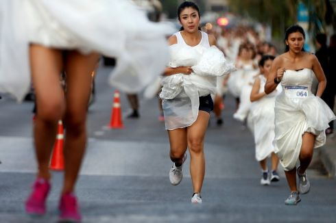 RUN TO THE AISLE: Brides compete during the 'Running of the Brides' race event in Bangkok, Thailand on November 24th. The winner receives a fully sponsored wedding as a prize. Photograph: Soe Zeya Tun/Reuters