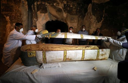 OPENING THE LID: Archaeologists remove the cover of an intact sarcophagus inside the tomb TT33 in Luxor, Egypt on November 24th. Photograph: Mohamed Abd El Ghany/Reuters