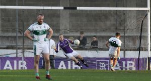 Kilmacud's David Nestor saves a penalty from Craig Rogers of Portlaoise that would have drawn the game. Photograph: Lorraine O'Sullivan/Inpho