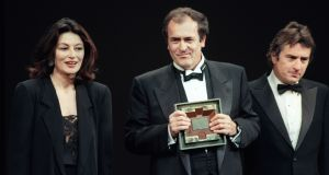 Actors Anouk Aimee and Robert De Niro present Bernardo Bertolucci with a special award for his film The Last Emperor during the 1987 Cannes International Film Festival. Photograph: AFP/Getty Images