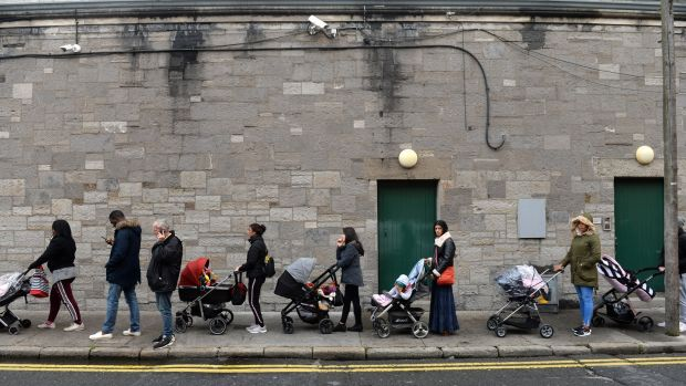A queue forms outside the Capuchin Day Centre for family necessities on Monday morning. Photograph: Dara MacDónaill/The Irish Times