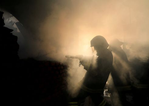 Firefighters work to put out a fire at a warehouse in Kathmandu, Nepal. Photograph: Navesh Chitrakar/Reuters