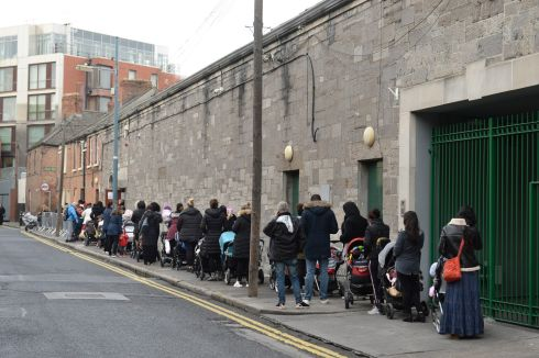 A large queue of parents and children form outside the Capuchin Day Centre where they give out baby supplies (nappies, baby formula milk and other items) to families in need. Photograph: Mac Donaill/The Irish Times