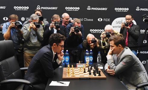 Norway's World Chess Champion Magnus Carlsen (right) plays against US challenger Fabiano Caruana at the Round Twelve game during the World Chess Championship 2018 in London. Photograph: Facundo Arrizabalaga/EPA