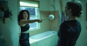 Eve (Sandra Oh) tries to defend herself against assassin Villanelle (Jodie Comer) in the BBC's eight-episode hit 'Killing Eve'. Photograph: Sid Gentle Films / BBC
