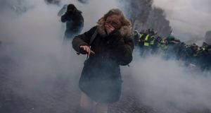 Citizens protest against higher fuel prices during clashes with police on the Champs-Élysée. Photograph: Julien de Rosa/EPA