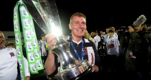 Dundalk Manager Stephen Kenny celebrates with the Premier Division trophy. Photograph: Ryan Byrne/Inpho