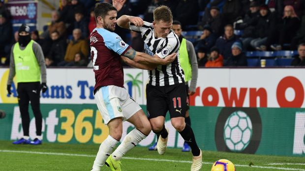 Matt Ritchie - pictured being tackled by Burnley's Robbie Brady - missed a golden chance to extend Newcastle's lead at Turf Moor. Photograph: Paul Ellis/AFP
