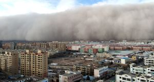 25/11/18: A sandstorm hits the city of Zhangye in Gansu province, China. Photograph: REUTERS/stringer