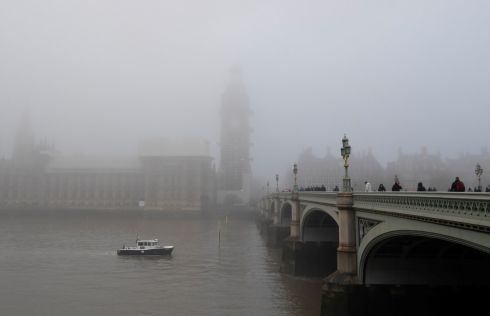 27/11/18: People cross Westminster Bridge as the Houses of Parliament are shrouded in fog in London, England. Photograph: REUTERS/Toby Melville