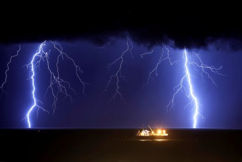 Lightning strikes over the Mediterranean sea during a rainstorm near the city of Ashkelon, Israel. Photograph: REUTERS/Amir Cohen