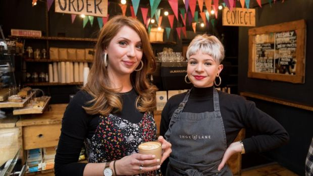 Jane Lunnon with one of Shoe Lane's staff, Juliana Sloane from Brazil: 'We don't hire baristas. We hire people with an interest in coffee and personalities and train them.' Photograph: Tom Honan