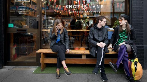 Relaxing outside Shoe Lane. 'We get cool young customers, but we get suits too – everybody, all ages.' Photograph: Tom Honan