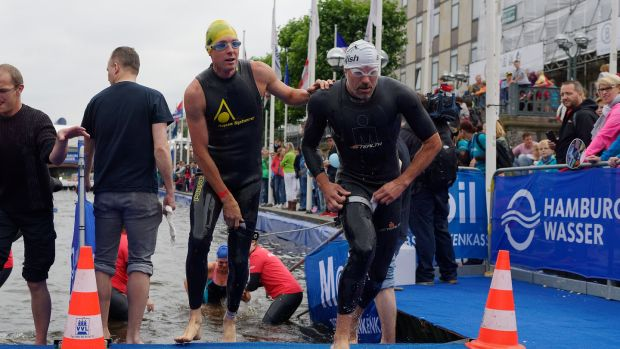 A blind paratriathlete is led out the water by his assistant at the ITU World Triathlon Hamburg in Hamburg, Germany in 2016. Photograph: Petko Beier/Getty Images