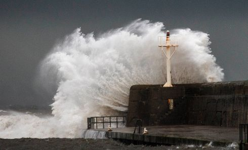 STORM DIANA: Massive waves break over the south pier in Arklow, Co Wicklow, as the early effects of Storm Diana bite along the east coast of Ireland. Photograph: Garry O'Neill