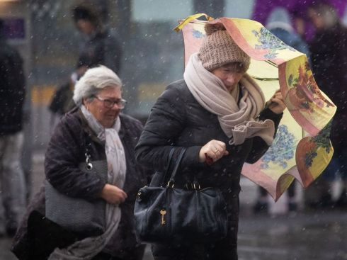 WRITTEN ON THEIR FACES: Two women get the real feeling of winter amid stormy conditions in Dublin city. Photograph: Tom Honan/The Irish Times