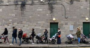 A queue forms outside the Capuchin Day Centre for family necessities on Monday morning. Photograph: Dara MacDónaill