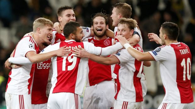 Ajax celebrate their progression into the last-16 of the Champions League. Photograph: Costas Baltas/Reuters