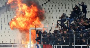 Ajax's 2-0 win away to AEK Athens was marred by crowd trouble. Photograph: Costas Baltas/Reuters