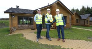 FastHouse has announced the completion of its contract to build lodges at the Center Parcs resort in Co Longford. Pictured are Sisk senior contracts manager Cormac Fitzpatrick, Center Parcs construction and development director Paul Kent and FastHouse sales and installations director Sean Fox Photograph: Conor McCabe photography