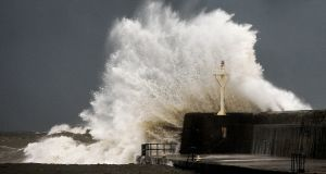 Large waves break over the south pier in Arklow, Co Wicklow, on Tuesday.  Photograph: Garry O'Neill