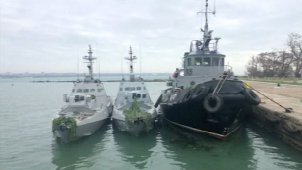 Ukrainian ships detained in Kerch Strait on Sunday are seen at a dock in this still image from video released by the Russian Federal Security Service.