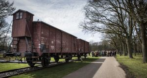 Two original railway boxcars from the Westerbork transit camp at the memorial centre in Hooghalen, the Netherlands. Photograph: Siese Veenstra/EPA