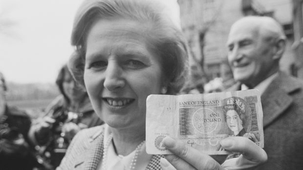 Loadsa money: Margaret Thatcher holding a £1 note in April 1979. Photograph: Evening Standard/Hulton Archive/Getty Images