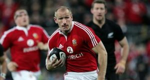 Gareth Thomas playing for the Welsh national rugby team, which he captained