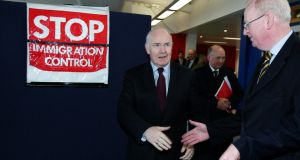 Then home secretary John Reid and minister for justice Michael McDowell at Dún Laoghaire Ferry Terminal in 2007, where they inspected co-operation arrangements for immigration between Ireland and the UK under Common Travel Area. Photograph: Frank Miller