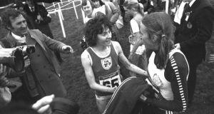 Mary Purcell who finished sixth, congratulates the winner Gretta Waitz from Norway in the 1979 World Cross Country championships  in Limerick. Photograph: Pat Langan